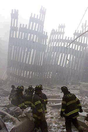 Peter Morgan/ReutersFiremen work around the remains of the World Trade Center after two planes