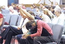 Approximately 175 people attended a Community Prayer Vigil for America at the Captial Chrisitian Center on Wednesday evening.