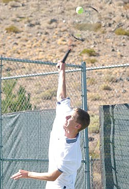Josh Brekken serves during his first doubles match which won 6-0 partially due to his and Andy Araza's, his partner's, over powering serve. Photo by Brian Corley