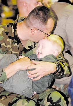 Aaron Bosley plays with his son, Ethan, 2, during send-off ceremonies at the Ohio National Guard, Monday, Oct. 8, 2001, in Canton, Ohio. Co D 1-148th Infantry Company will be leaving Tuesday morning for Kentucky. (AP Photo/The Repository, Joy Newcomb)