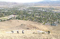 Members of the Steward Conservation Camp clear an area roughly 180 X 75 feet just above the C on C Hill Wednesday morning.   photo by Rick Gunn