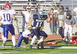 Nevada quarterback David Neill (11)  rushes for a touchdown during the fourth quarter Saturday, Oct. 13, 2001, in Reno, Nev.    Louisiana Tech won 45-42. (AP Photo/Nevada Appeal, Cathleen Allison)