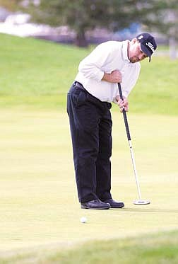 Brian Kortan putts on the first hole at Dayton Valley Golf Course on Wednesday morning during the 2001 PGA tour qualifier.