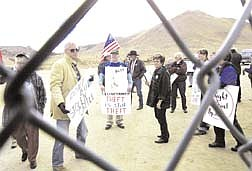 About 50 demonstrators were kept at bay amid tight security Tuesday, as U.S. Bureau of Land Management officials auctioned off cattle confiscated in a dispute over grazing fees.  The auction, held in Palomino Valley, north of Reno, Nev., resulted in the sale of the 62 head of cattle for $13,000.