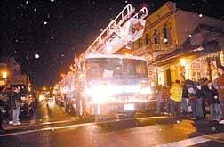 The Virginia City Fire Department was just one of the particapants in the Virginia City Christmas Lights Parade as hundreds of spectators braved the cold weather and snow. Photo by Brian Corley