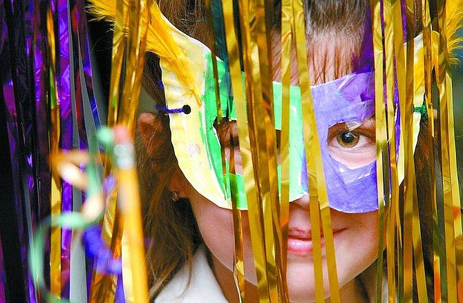 Rick GunnShannon Flaherty, 6, shows off her Mardi Gras mask at St. Teresa School on Tuesday afternoon.