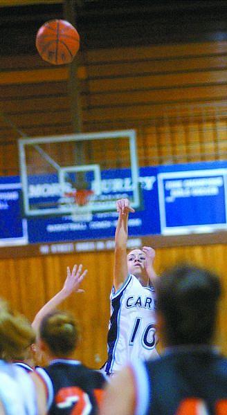 Ciarra Christian shoots sinks a three-pointer Tuesday evening against DHS at Carson.  photo by Rick Gunn