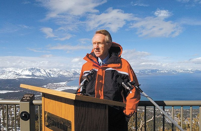 U.S. Senator Harry Reid speaks with reporters at the top of Heavenly Ski Resort over looking South Lake Tahoe Saturday. Reid spoke out against Pres. Goerge W. Bush's decision to support the Yucca Moutian nuclear dump facility calling the decision a broken campaign promise against the people of Nevada. Both republicans and democrats from Nevada have voiced their disapproval in Bush's decision. Photo by brian Corley