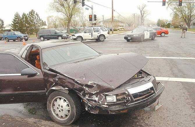 Photo by Brian CorleyA Chrysler LeBaron is disabled after it collided with an Isuzu Rodeo at Fith Street and Saliman late Thursday morning. Despite the heavy damage to both vehicles there wre only minor injuries.