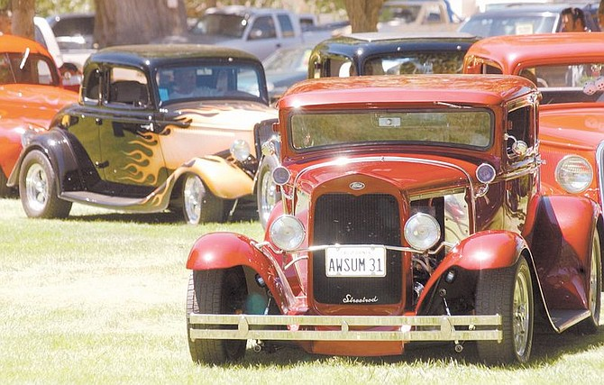 Jim Warden in his 1931 Ford Model A Coupe waits in line for his award along with others at the Run What Cha Brung Car Show at Fuji Park Sunday. Photo by Brian Corley