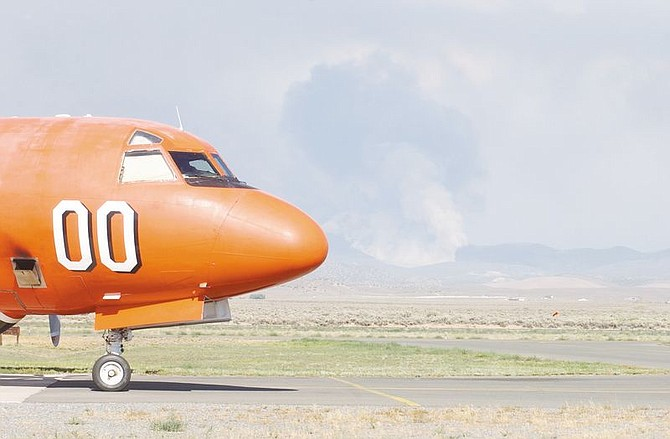 A P-3 Orion Air Tanker waits as it reloads to fight the Buckeye Fire south east of Johnson Lane. The fire, which was started by lightening, was inaccessable by the ground so was fought by a lone tanker as several others helped with other fires in the area. photo by Brian Corley