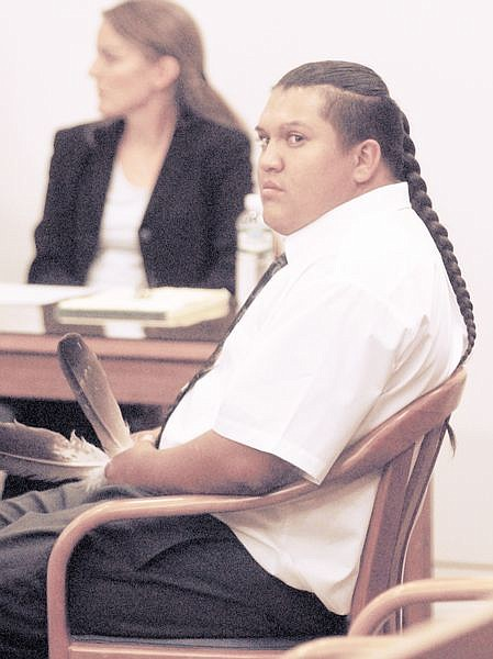 Rocky Boise, jr. sat in the carson City courts holding two feathers throughout the resendiz hearing Monday. Photo by Brian Corley