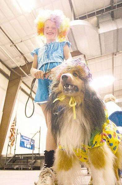 Jacki Dunt, 9, and her dog, Laddy, came to the Pets and Projects Parade as clowns. Photo by Brian Corley