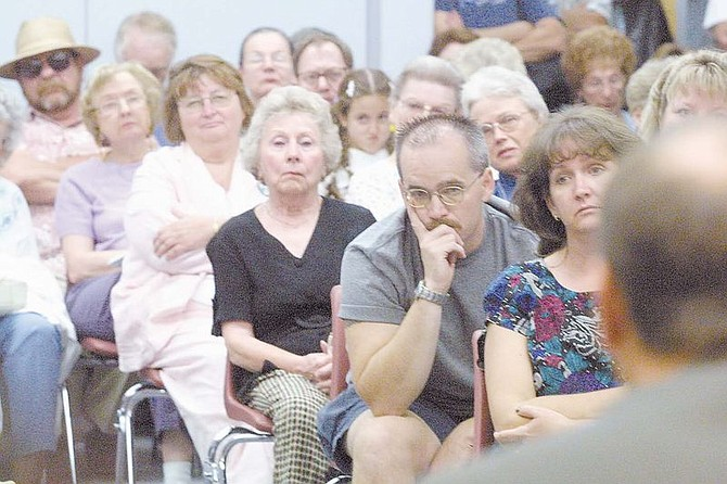 Audience members listen intently during Thursday's League of Women Voter's forum for Carson City sheriff candidates. About 100 people packed the Sierra Room to question the five candidates before the Sept. 3 Primary Election. Candidate Kenny Furlong is in the foreground to the far right answers a question about drug problems in Carson City.