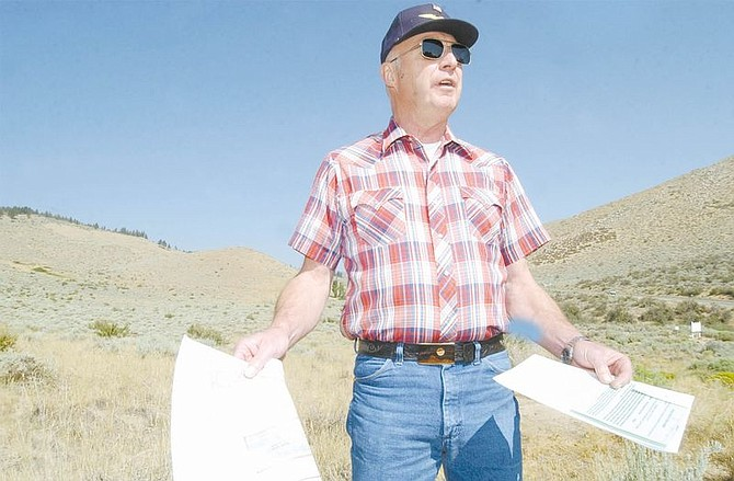 Lee Carter stands on property at the intersection of Coombs Canyon Road and Timberline Drive that is slated to have 90 homes on 19 acres in an area where homes are on 1/3 to one acre lots. Carter says the development is planned to densly for the area. Photo by Rick Gunn