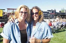 Kelli Newman, left and Jennifer Russell, who were auctioneers for the silent auction, stand in front of a train during the Annual Boys and Girls Club Fund Raiser at the Nevada State Railroad Museum. The Boys and Girls Club  Photo by Brian Corley