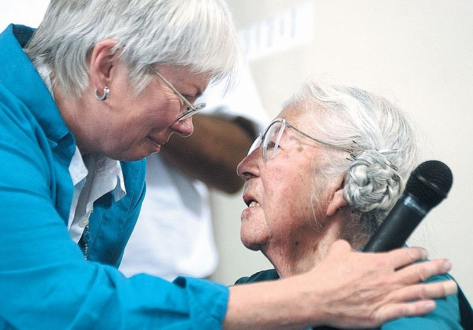 Lynn Farrer, left, who read a proclamation from Gov. Kenny Guinn, wishes Winona James a happy 100th birthday. James later got up to dance. Photo by Brian Corley