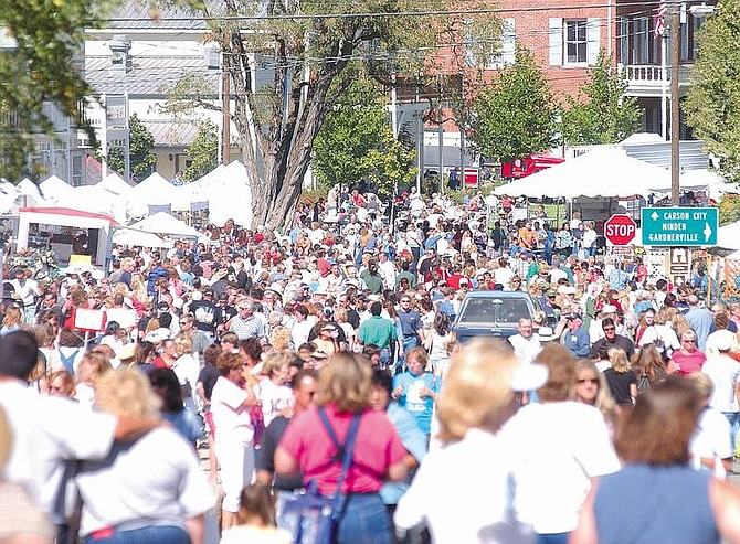 Photo by Brian Corley.Thousands of shoppers flooded Genoa on Saturday for the 82nd Candy Dance Arts and Crafts Faire. The fair is also open today.