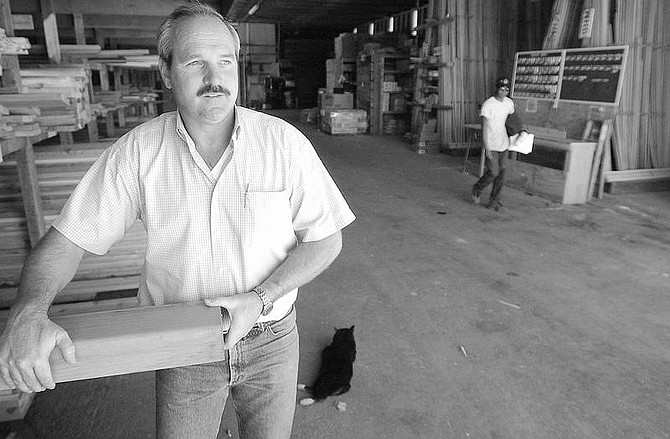 Rick Gunn photoGary Somers, sales representative for Tum-A-Lum Lumber Co., formerly Copeland's Lumber, stands in the indoor ara of the Carson City lumberyard on Tuesday afternoon.