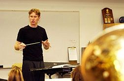 Rick GunnRyan Rothchild directs Carson High's Blue Thunder band on Tuesday.