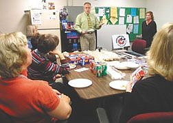 Dr. Gregg McAninch, center, and Dr. Betsy Card, right rear, were grilled by Fritsch Elementary School teachers on Wednesday concerning breast cancer detection.