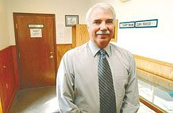Retired LAPD Detective seargent Rich Zeirenberg stands in the Dayton Court House Wednesday afternoon. He has just been appointed as Lyon County'e  first full-time code enforcement officer.