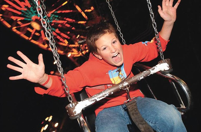 Photo by Brian CorleySean Epley, 10, lets out a scream at the Nevada day Carnival while riding the Yo-yo thursday night. The Carnival will continue through Sunday during the Nevada Day weekend.