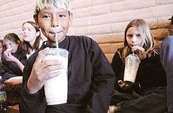 Rick GunnEagle Valley Middle School's Nathan Morales and Brittany Middleton enjoy root beer floats Friday afternoon, part of their reward for doing good deeds. Students caught in random acts of kindness are referred to the principal for recognition.