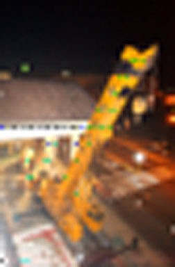 Brian CorleyThe Greco-Roman-style roof structure on the east side of the Ormsby House, known as a 'portecochere,' was set to be removed early this morning by a huge crane. The project closed one southbound lane of Carson Street for several hours.