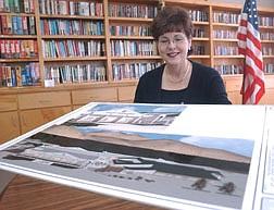 Janice McIntosh sits in the library of the Carson City Senior Citizen's Center with an artists rendering of the center after it has undergone an expansion. Photo by Brian Corley
