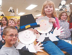 Casey Wolfe, 7, left, and Ashlee Salsubry, 7, hold their Thanksgiving pilgrims along with the rest of their kindergarten class. Elementry school classes all over Carson City are making thanksgiving projects to learn more about the histroy of the holiday. Photo by Brian Corley