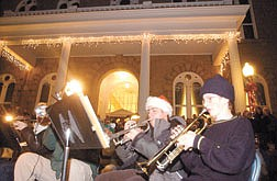 Justin Stearns, 13, right, plays christmas carols with the Holiday Brass Ensemble at the Nevada State Capitol Steps during the Silver and Snowflakes 2001 Traditional Christmas Tree Lighting. Photo by Brian Corley