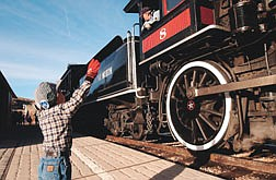 Noah Jennings, 4, tries to help guide the train into the station at the Nevada State Railroad Museum Friday. The Museum has a steam-up all weekend in an effort to help collect toys for the Toys for Tots charity that will deliver them in time for christmas. Photo by Brian Corley
