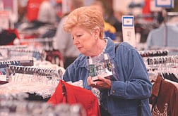 Sandra Rich looks through the clothing racks at Gottschalks Friday. Rich along with millions of others hit the stores Friday looking for sale prices to start the beginning of the Christmas shopping season. Photo by Brian Corley