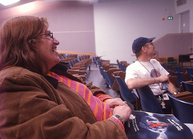 Photo by Brian CorleyAndrea Katz, left, and Jim Welsher sit in an auditorium at the University of Nevada Reno watching a video of the MTV documentary 'Staying Alive.' The documentary was shown as part of the AIDS Awareness week. Both Katz and Welsher are HIV positive.