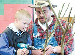 Dakota Machal, 6, inserts a screw while creating a willow Reindeer with Willow Bill at Bordewich Bray Elementary Tuesady afernoon.  photo by Rick Gunn