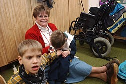 Ellen Boyd, a teacher at Seelinger Elementary School, comforts two of her students, Bradley Pine, 7, left, and Kevin Hinez, 6, during a school lockdown drill. The drill was held during an American Federation of Teachers Union meeting and had been planned for quite a while despite a real lock down in the Sparks area Wednesday. Photo by Brian Corley