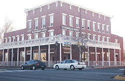 Cars drive by the St. Charles Hotel and what used to be the stage coach drop off station in Carson City. The hotel appears much the same as it did when it was built in 1859 except the town has gone through many changes including the paved roads in front of the hotel. Photo by Brian Corley