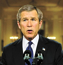 President Bush stands in the White House Cross Hall after addressing the nation on his ultimatum to Iraqi leader Saddam Hussein, in Washington, Monday, March 17, 2003.  (AP Photo/J. Scott Applewhite)