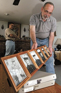 Dave Wyble, Sr., shows a collection of family photos of six Wyble men who have served in the Marines, including Wyble's son Brett who is currently stationed in Hawaii.