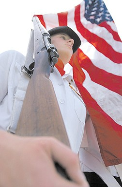 Megan Hanke, 14, presents the colors during the Memorial Day ceremony at the Lone Mountain Cemetery in Carson.