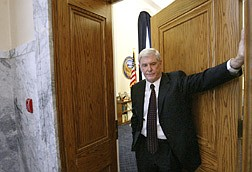 Nevada Gov. Kenny Guinn talks outside his office at the Capitol in Carson City, Nev., Monday, June 2, 2003. With a midnight adjournment of the 2003 legislative session nearing, Nevada lawmakers braced for do-or-die votes Monday on a tax compromise that would fill Nevada's $860 million budget gap. (AP Photo/Nevada Appeal, Cathleen Allison)