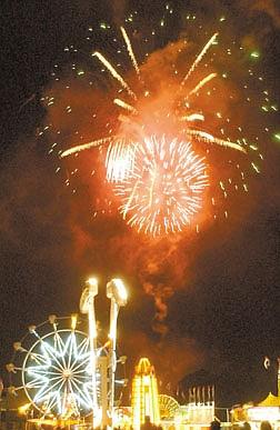 Fireworks boom over Mills Park Thursday evening..