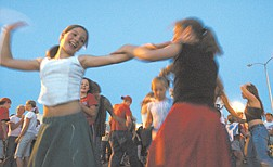 Veronica Jenks, 11, of South Lake Tahoe, from left, and Lauralee Bell, 13, of Gardnerville, dance Friday evening in the parking lot of the Carson Mall.