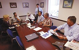 Seven of the 15 Nevada Republican legislators who voted against the tax package, from left, Valerie E. Weber, R-Las Vegas, Lynn Hettrick, R-Gardnerville, John C. Carpenter, R-Elko, David Brown, R-Henderson (standing), Rod Sherer, R-Pahrump, Ron Knecht, R-Carson City, and Pete Goicoechea, R-Eureka, meet in Hettrick's office in the Legislative Building in Carson City, Nev., Sunday, June 29, 2003. (AP Photo/Las Vegas Review-Journal, K.M. Cannon)