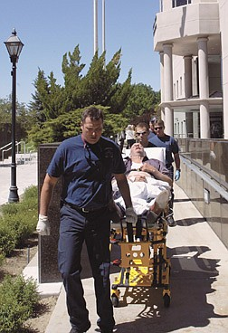 Nevada Assemblyman Tom Collins, D-North Las Vegas, is taken by paramedics from the Legislative Building in Carson City, Nev., after collapsing on the Assembly floor Monday, June 30, 2003. Collins complained of chest pains and will be under observation at Carson-Tahoe Hospital for 24 hours, preventing him from voting on a tax package by the midnight deadline. (AP Photo/Las Vegas Review-Journal, K.M. Cannon)