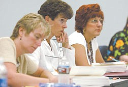 Western Nevada Community College students, from left, Artha Dutcher, Cathy Eckart and Laura Jarett listen during their English class on Monday afternoon.