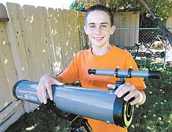 Shep Darquea, 14, used his telescope to watch Mars Tuesday night from his Carson City home.