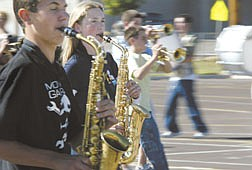 The Carson High School Blue Thunder marching band practices Wednesday afternoon in the south parking lot of the school.   A neighbor is complaining of the noise from their and wants them to change either the time or the location of their rehearsals.