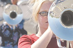 CHS marching band member Jennifer Sturm Plays horn  during marching band practice at CHS Thursday. photo by Ric Gunn